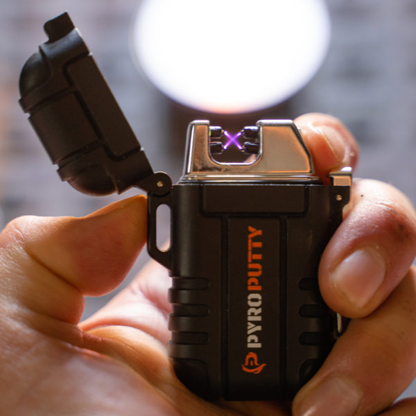 Dual arc lighter in the hand